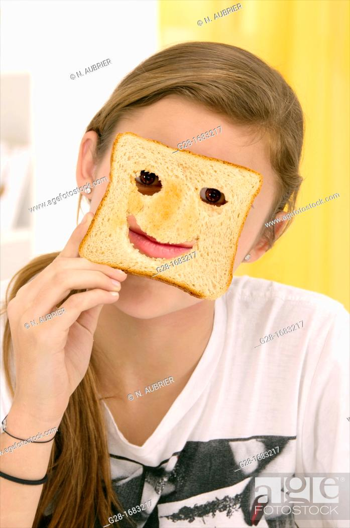 Stock Photo: beautiful teenage girl, hiding behind a toast with cut mouth and eyes.
