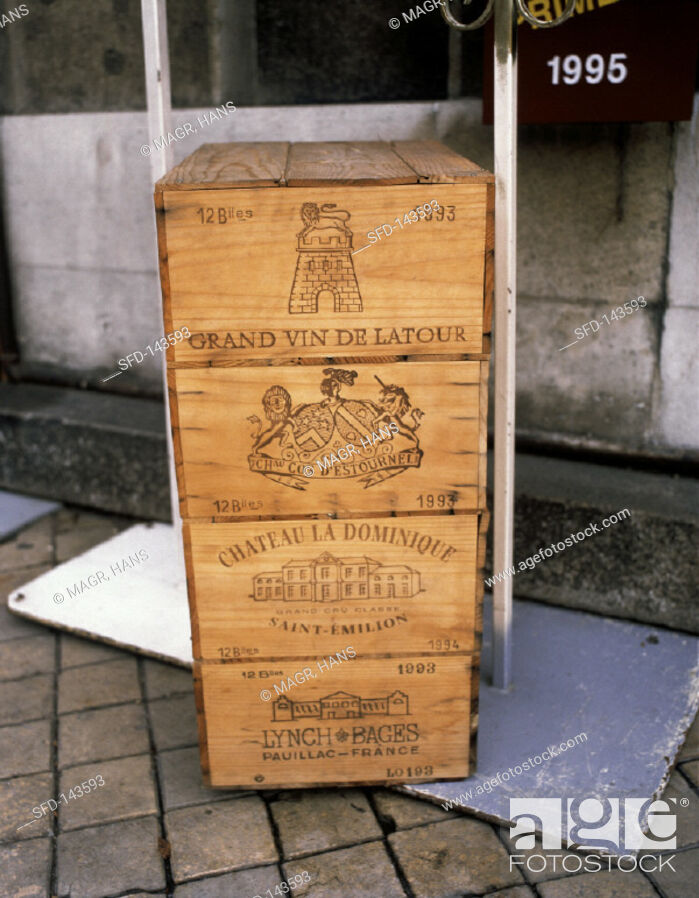 Stock Photo: Four cases of luxury wines from the Bordeaux region.