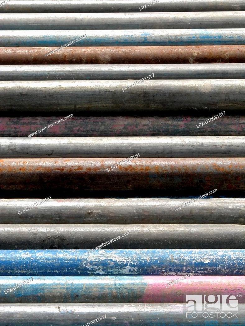 Stock Photo: Scaffold poles piled on site.