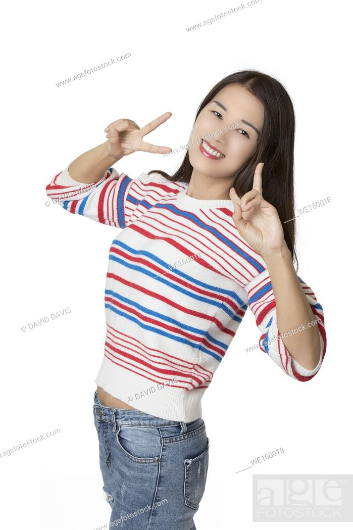 Stock Photo: Portrait of a Beautiful Asian American woman displaying a bit of attitude isolated on a white background.