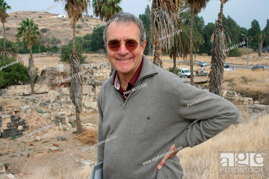 Stock Photo: The leading archaeologist Hans-Peter Kuhnen stands on the massive gate of the Caliph's palace, photographed at the shores of the lake Genezareth in Chirbat.