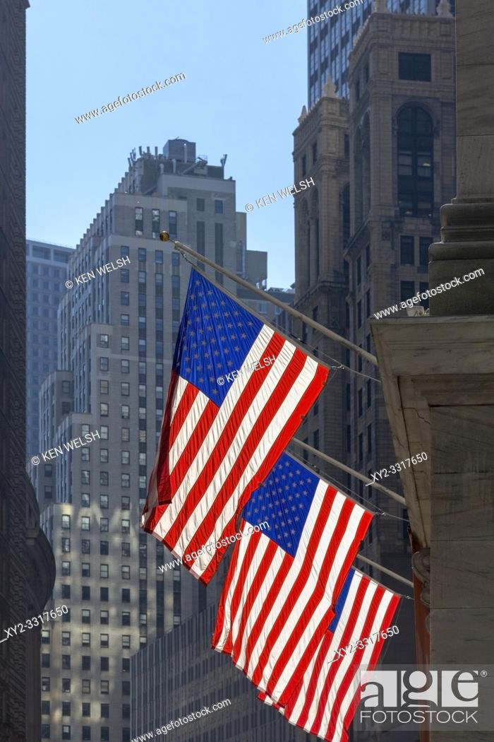 Stock Photo: Three American flags flying outside the New York Stock Exchange, New York, New York State, United States of America.