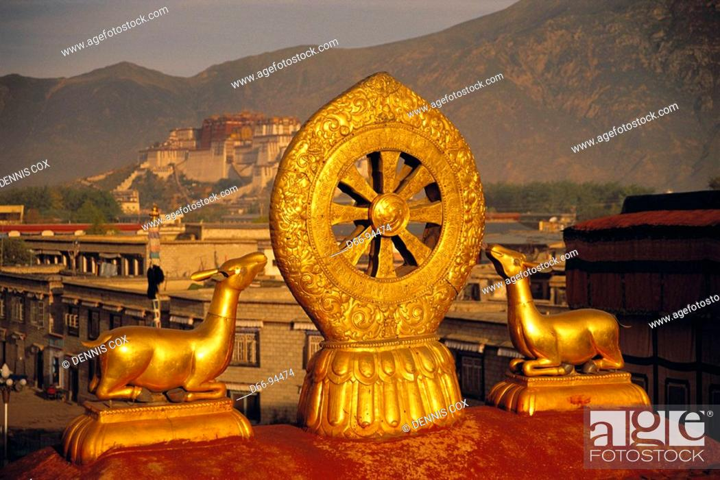 Stock Photo: Roof of Jokhang temple with Potala palace in background, Lhasa. Tibet, China.