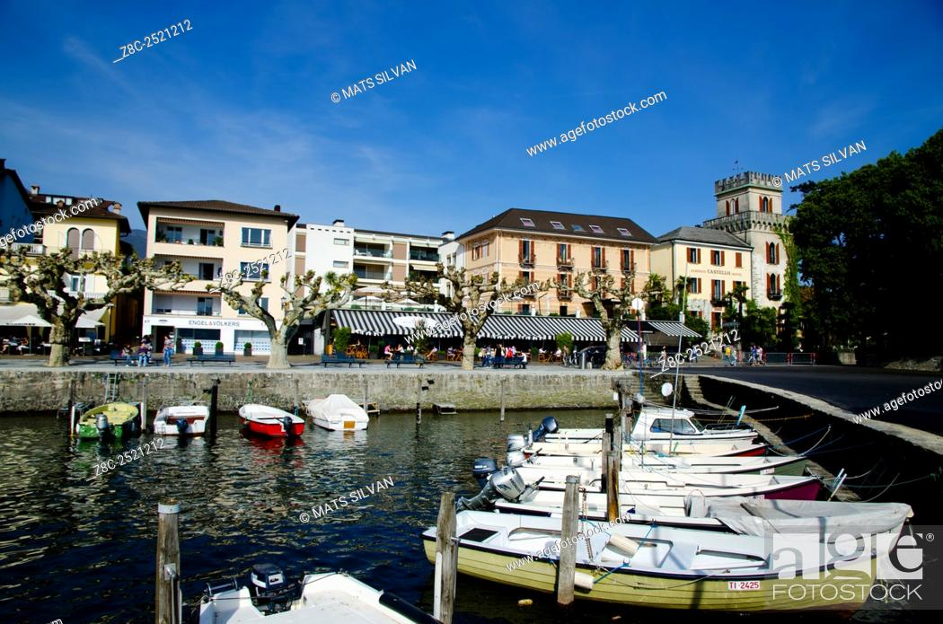 Stock Photo: Small harbor on an alpine lake Maggiore with a village in Ascona, Switzerland.