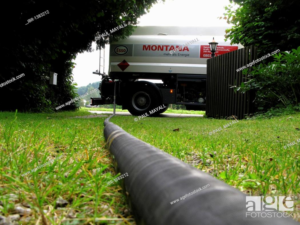 Home heating oil tank car and black hose pipe, Stock Photo