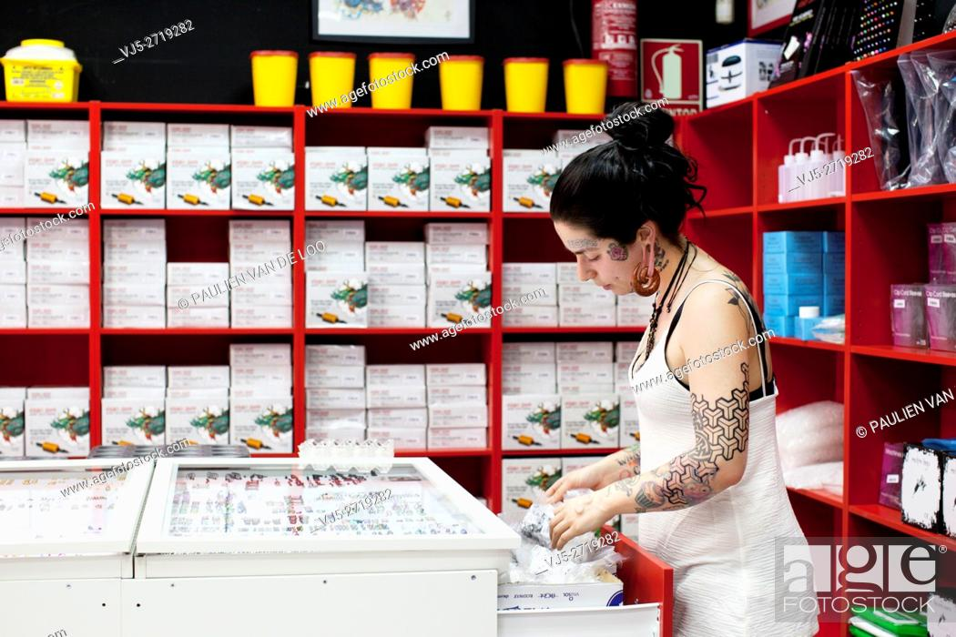 Stock Photo: Madrid, Spain, sales assistent at a tattoo and a piercing shop in Madrid.