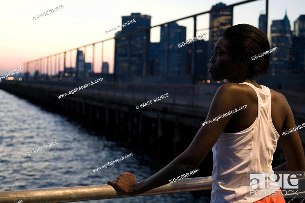 Stock Photo: Female runner by river.