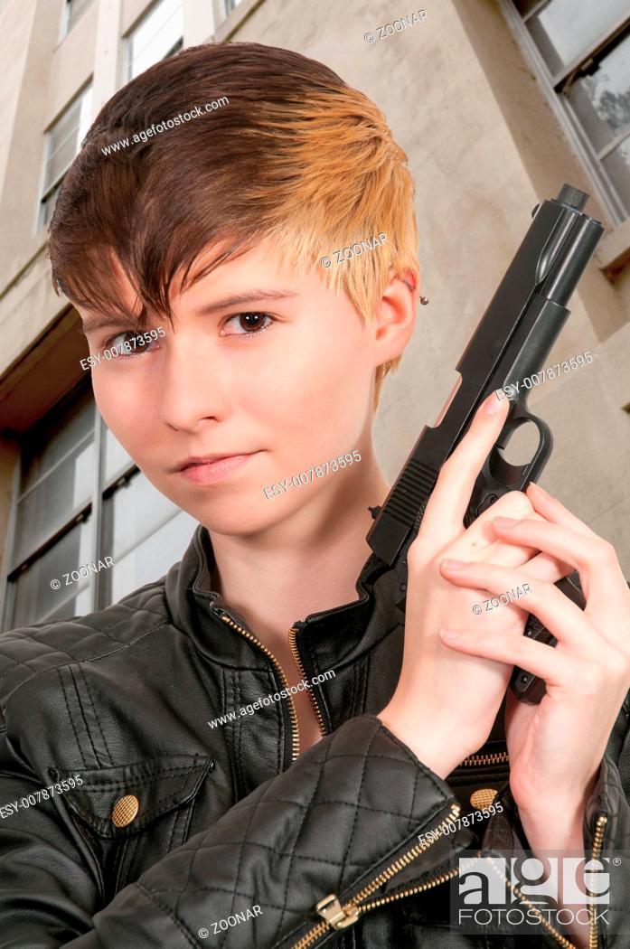 Stock Photo: Woman with Gun.