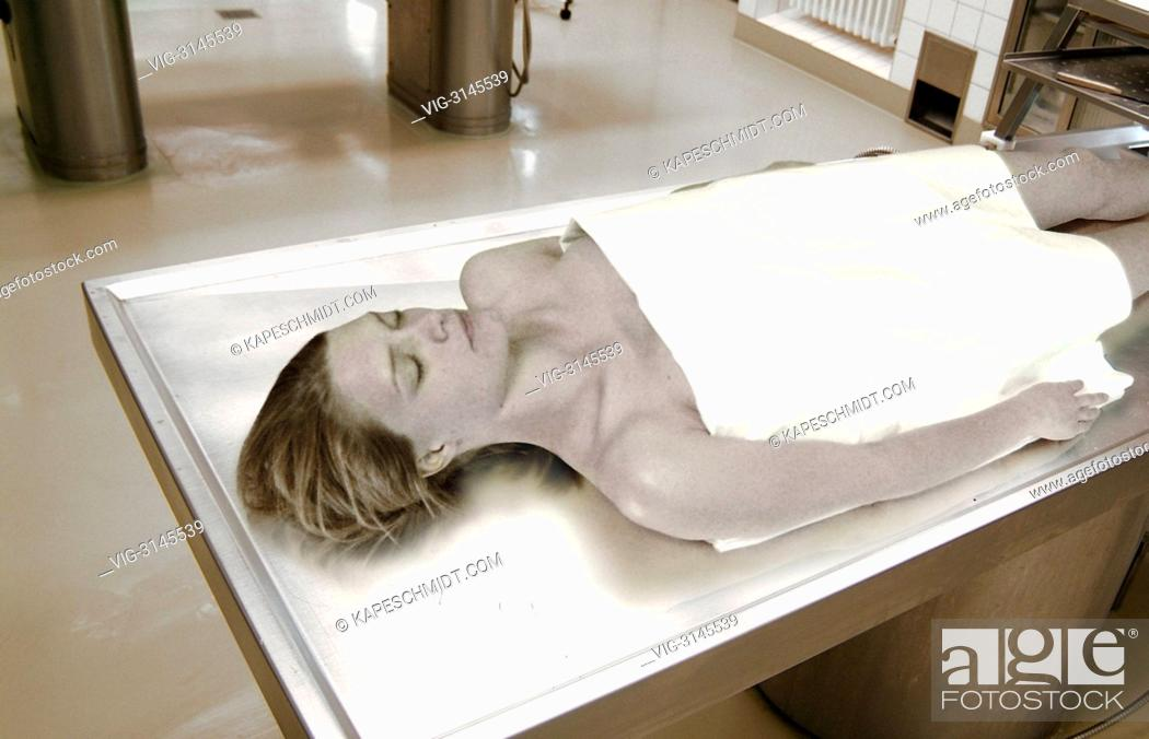 Dead body of a woman on an autopsy table in the forensic