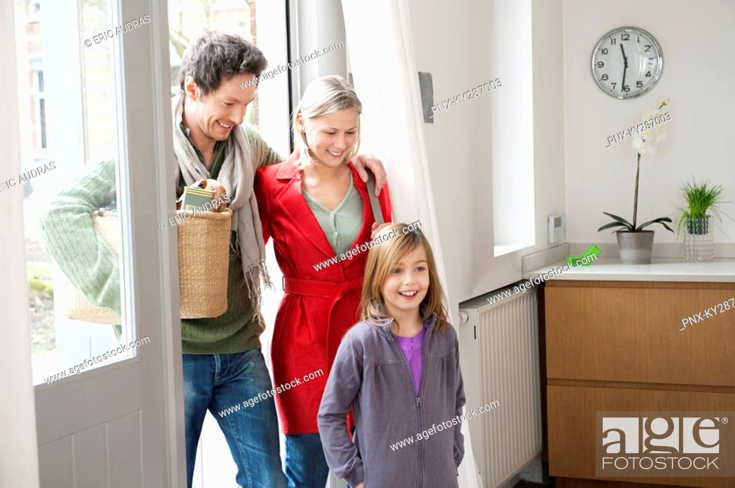 Stock Photo: Family entering the house.