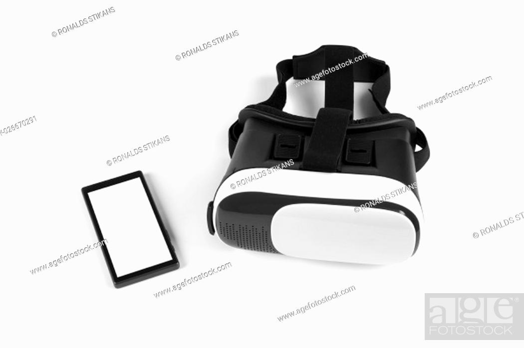 Stock Photo: virtual reality headset with blank smartphone on white.