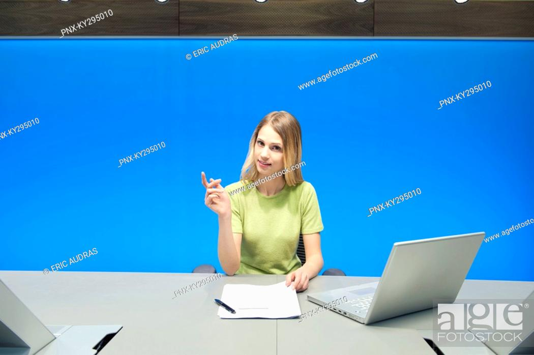 Stock Photo: Businesswoman in a conference room.