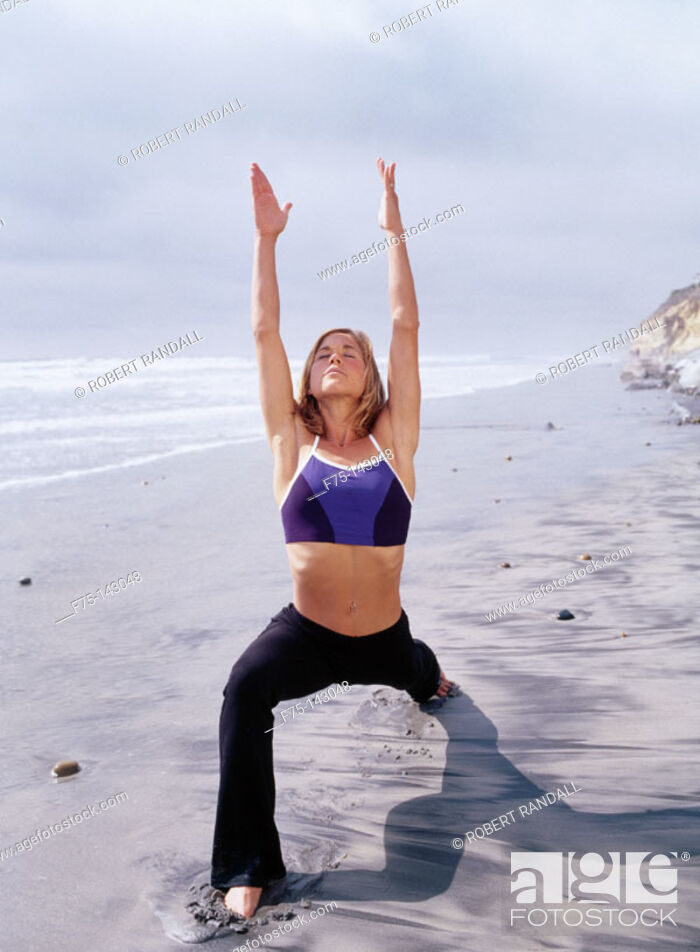 Stock Photo: Woman doing yoga at the beach.
