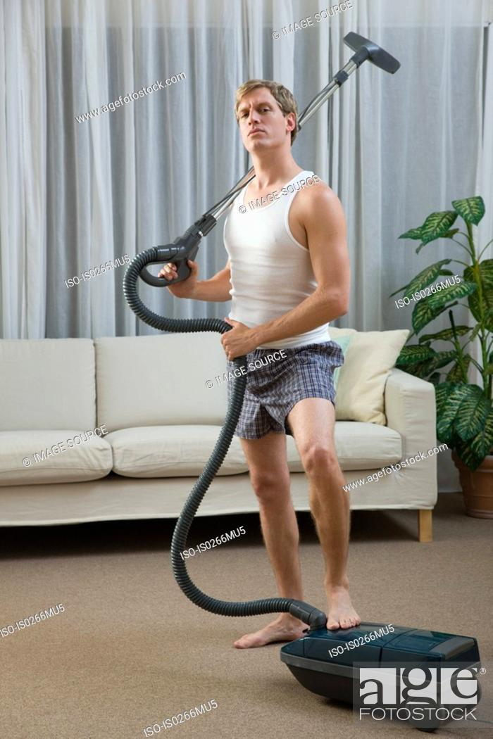 Stock Photo: Portrait of a man with a vacuum cleaner.