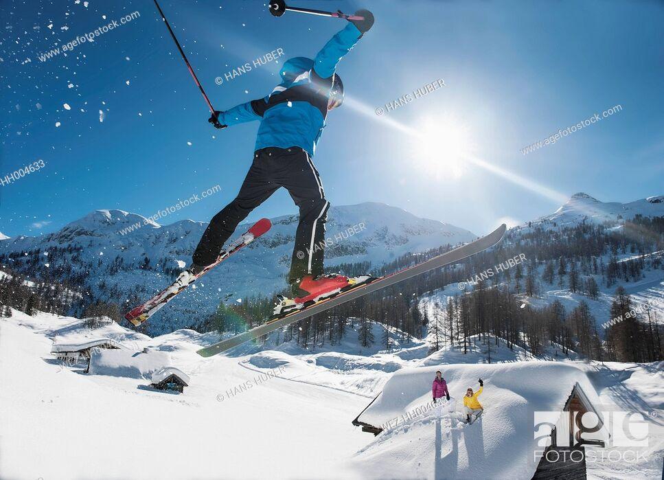 Stock Photo: Austria, Salzburg, Young man ski jumping in mountains.