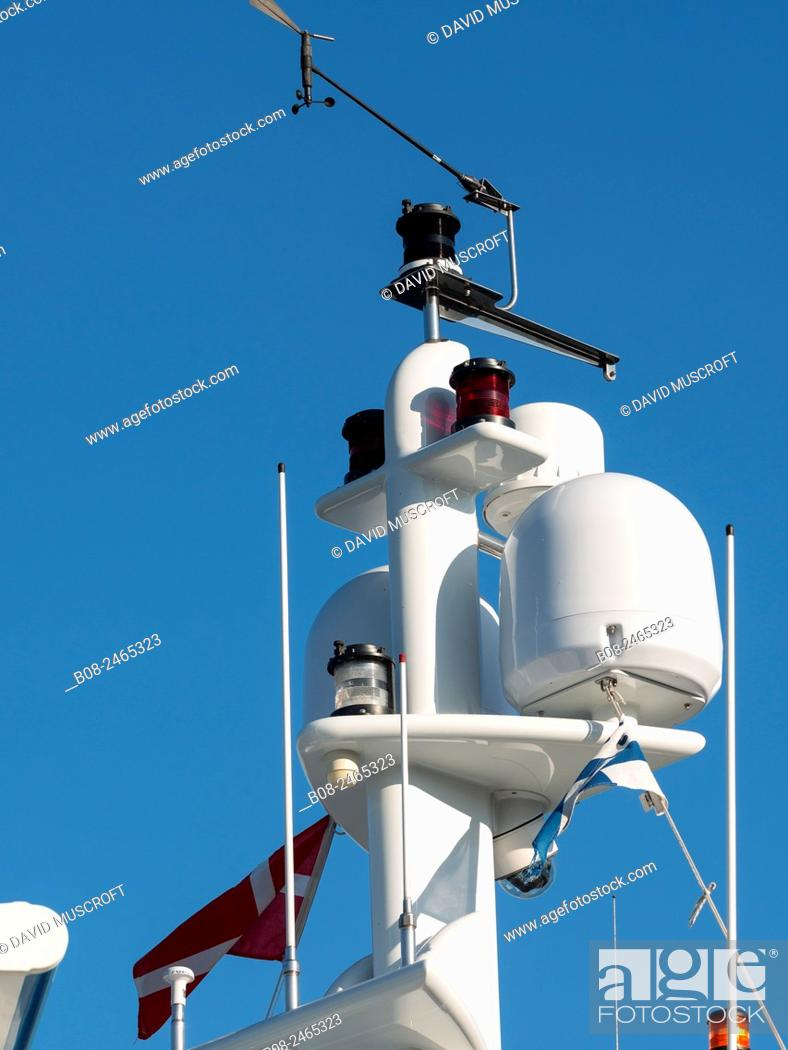Stock Photo: detail of radar and communications equipment of a modern yacht in the harbour, Copenhagen, Denmark.
