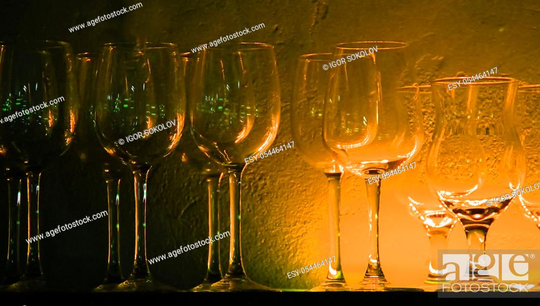 Stock Photo: 5 Wine glasses and glasses on a shelf in a bar, night club, many colors.