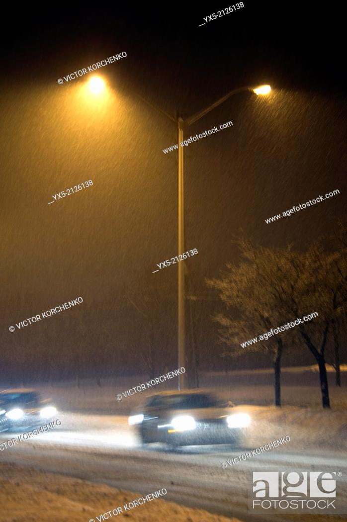 Stock Photo: Snow falling on a deserted street at night in Toronto suburbs.