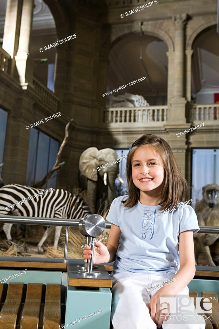 Stock Photo: Girl sitting in a museum.