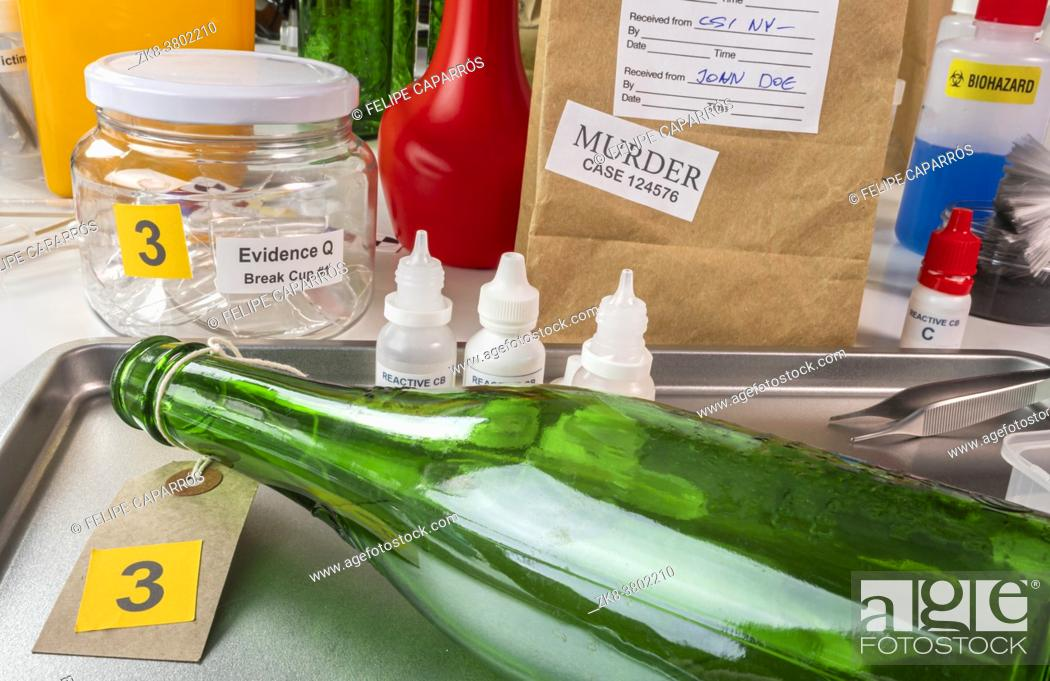 Stock Photo: samples from a broken glass bottle in Criminalistic Lab, conceptual image.