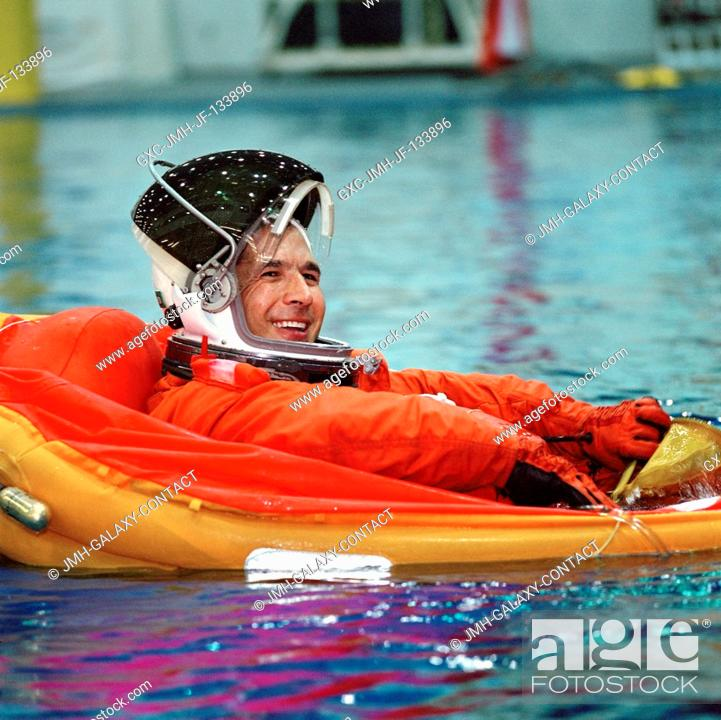 Stock Photo: Astronaut John B. Herrington, STS-113 mission specialist, floats in a small life raft during an emergency egress training session in the Neutral Buoyancy.