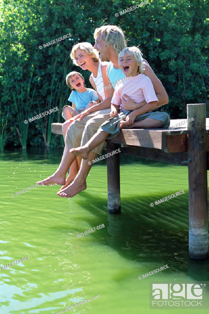 Stock Photo: Family on a jetty.