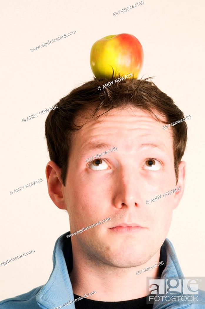 Stock Photo: looking to the apple.