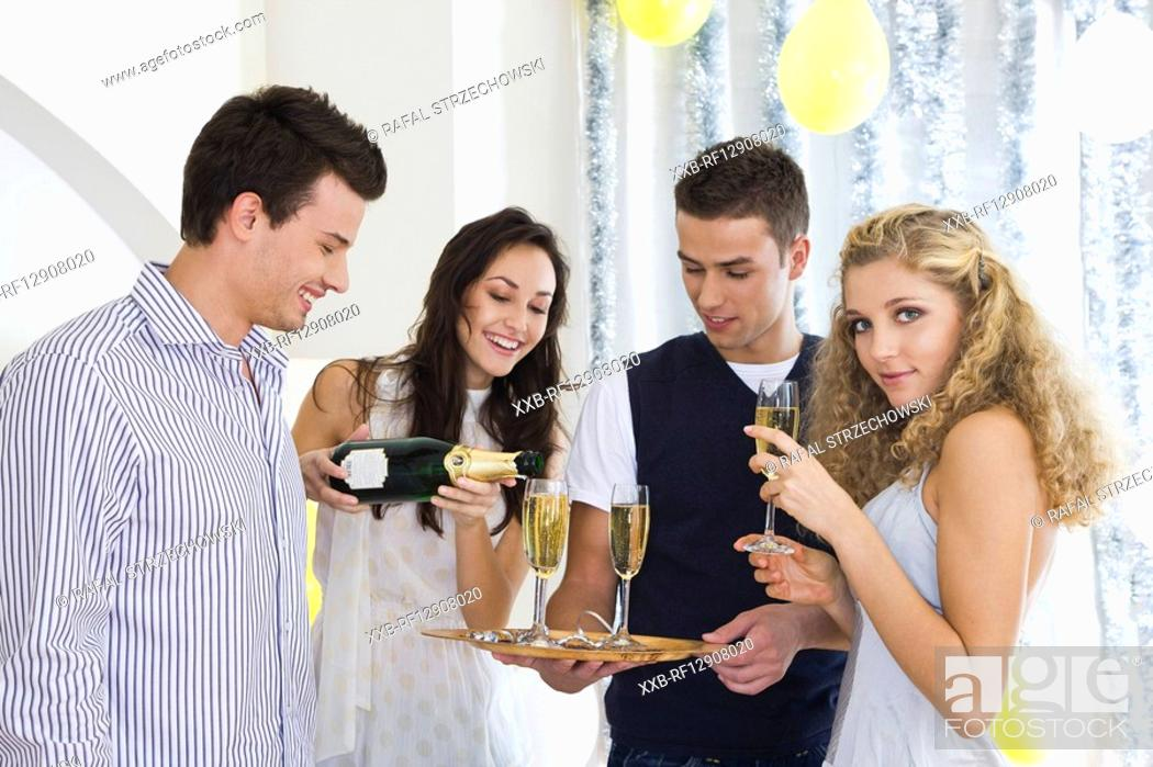 Stock Photo: friends drinking champagne at party.