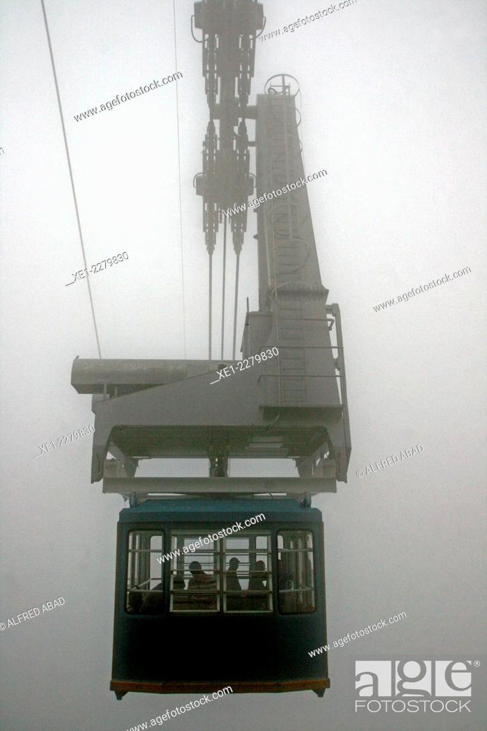 Stock Photo: Fog, cableway Sallente away Gento Lake, Torre Capdella, Pyrenees, Catalonia, Spain.