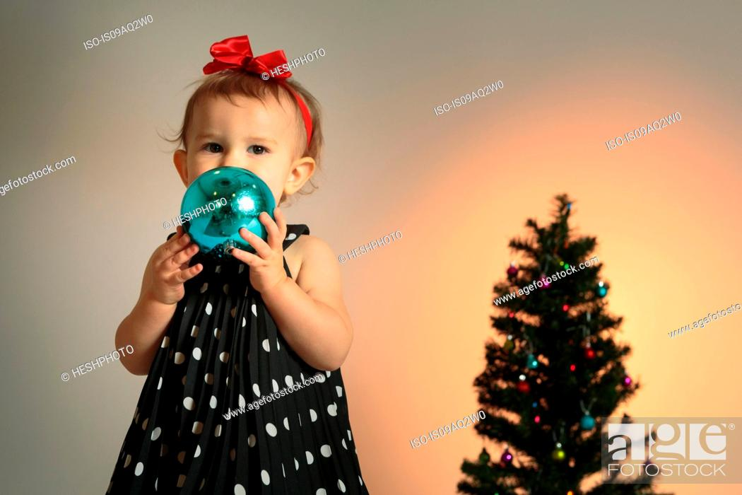 Stock Photo: Little girl with christmas bauble.