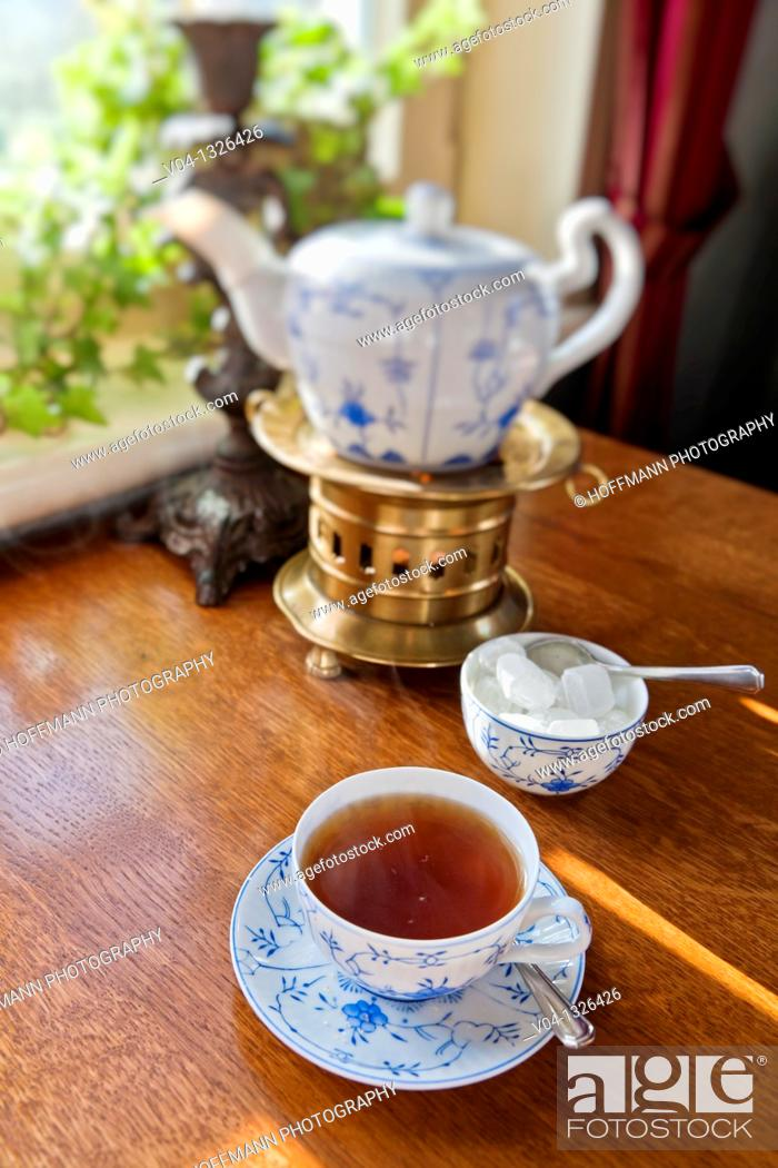 Stock Photo: Close up of a traditional east frisian tea time in a tearoom on the island of Spiekeroog, Lower Saxony, Germany, Europe.