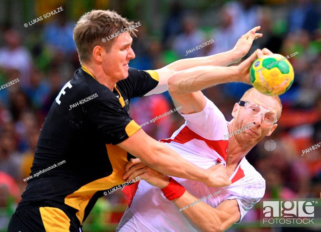 Finn Lemke L Of Germany In Action Against Karol Bielecki