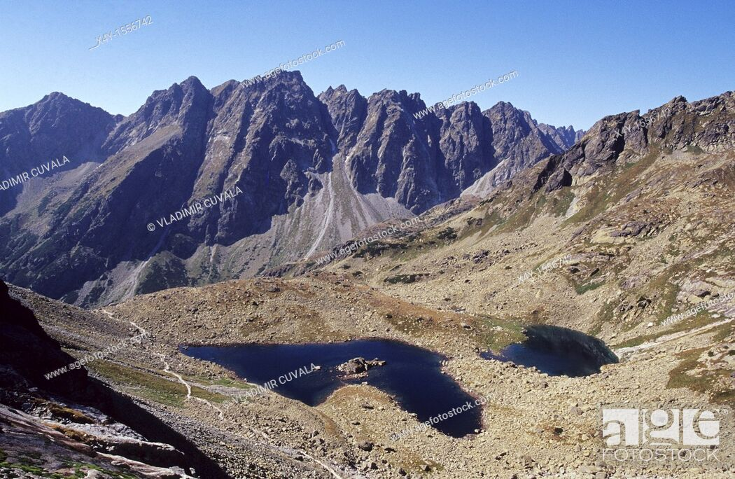 Stock Photo: The rugged High Tatras's peaks in Mengusovska dolina seen from the track leading to the summit of Rysy.