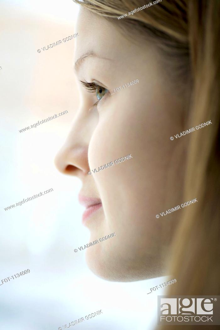 Stock Photo: Profile of young woman.