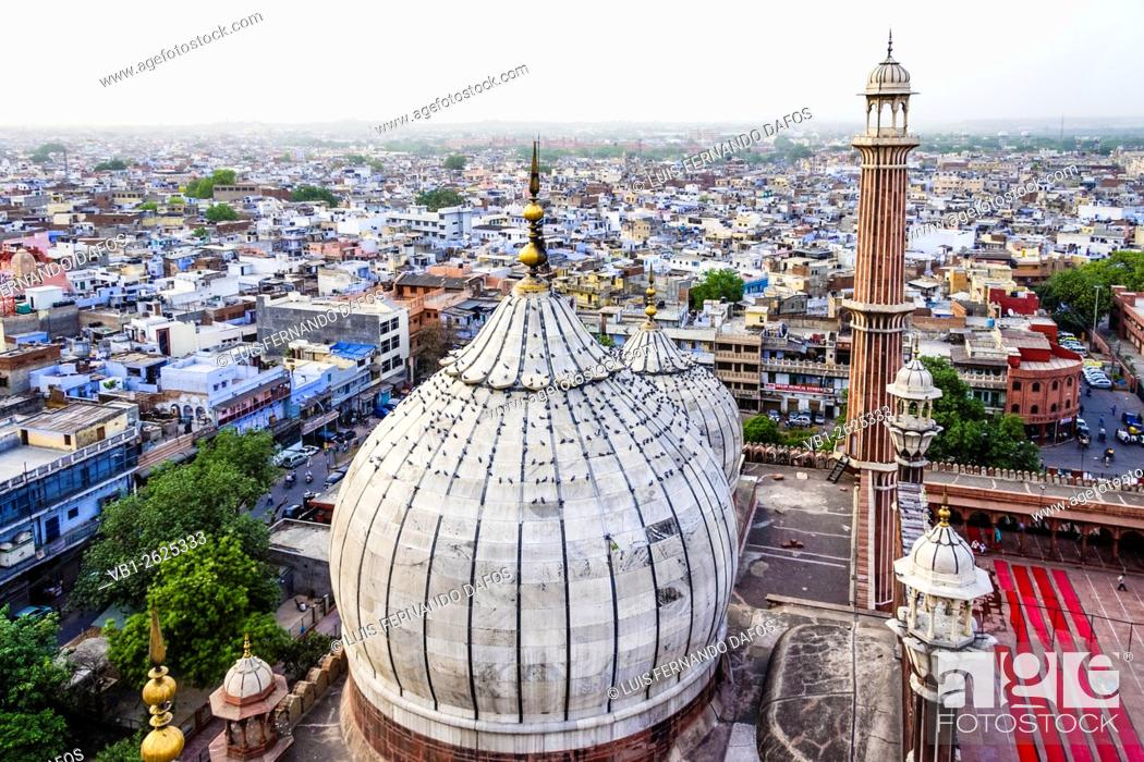 Stock Photo: Aerial overview of Old Delhi from minaret of Jamaa Masjid mosque with minaret and domes in foreground. Delhi, India.