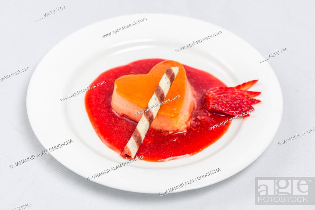 Stock Photo: Heart-shaped pudding with strawberry sauce and wafer. Valentine's dessert recipe.
