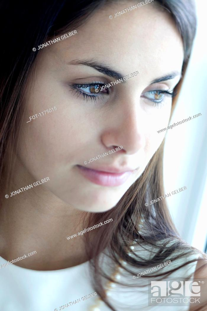 Stock Photo: Pensive woman with reflection in her eyes.