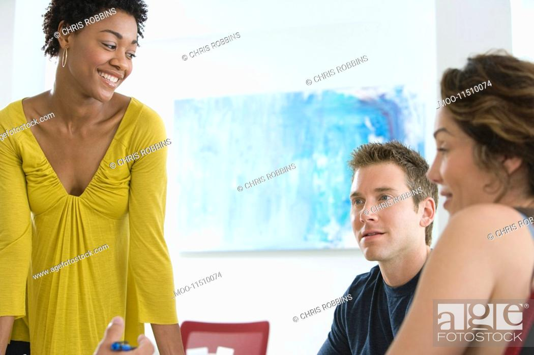 Stock Photo: Office workers having conference.