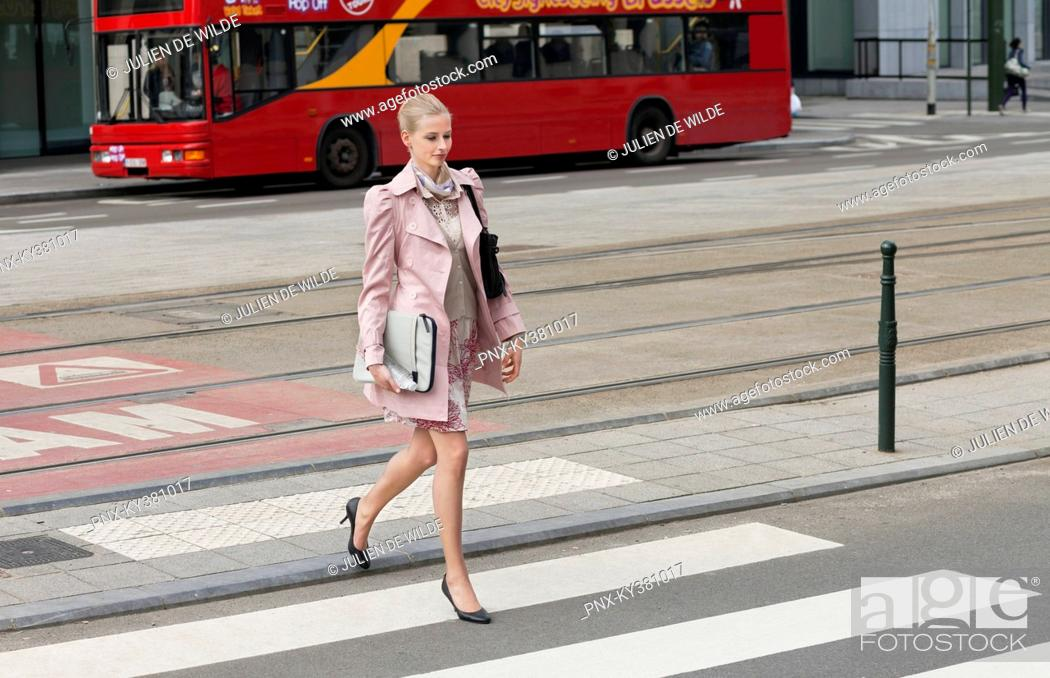 Stock Photo: Businesswoman crossing the road.
