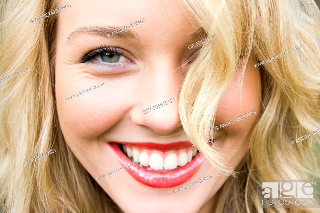 Stock Photo: close-up of a beautiful girl laughing.