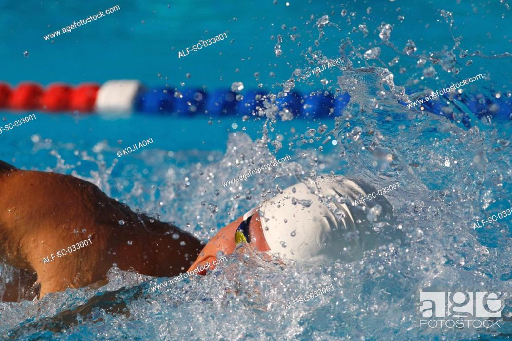 Stock Photo: Young swimmer doing front crawl swimming stroke.