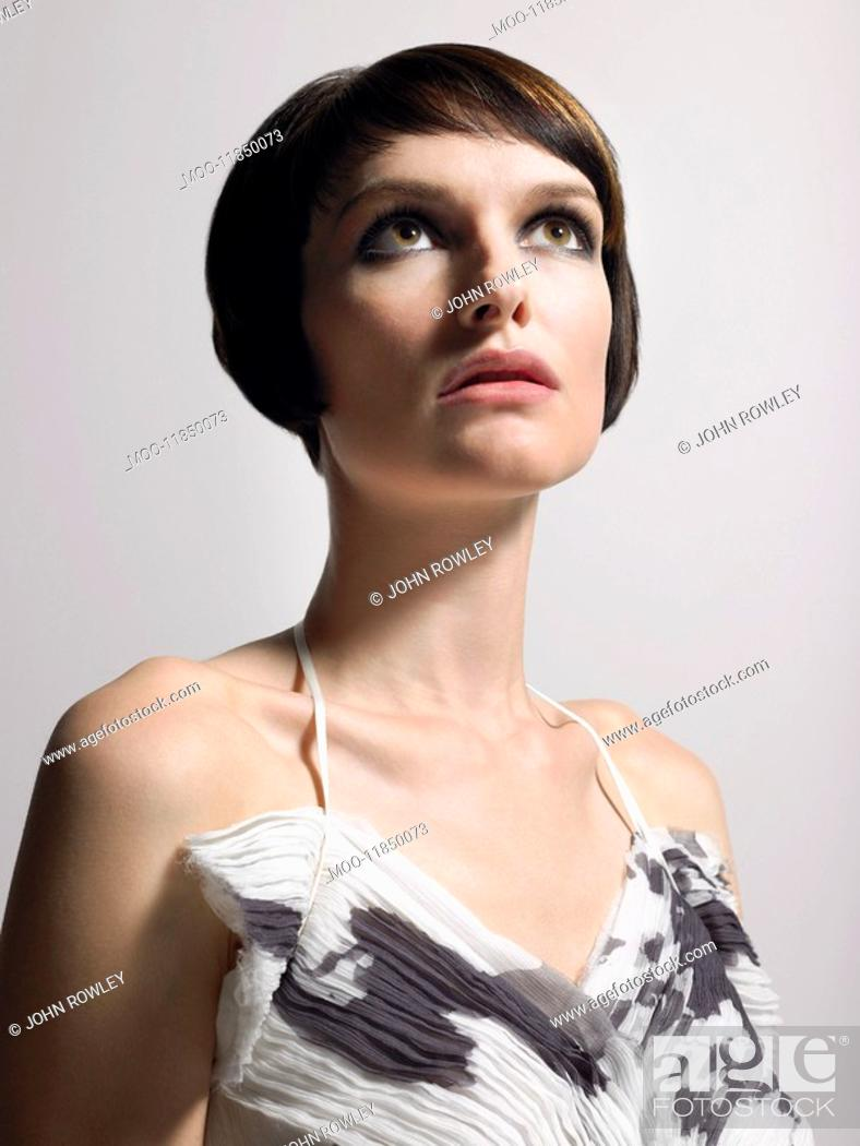 Stock Photo: Woman with bobbed hair in studio head and shoulders.