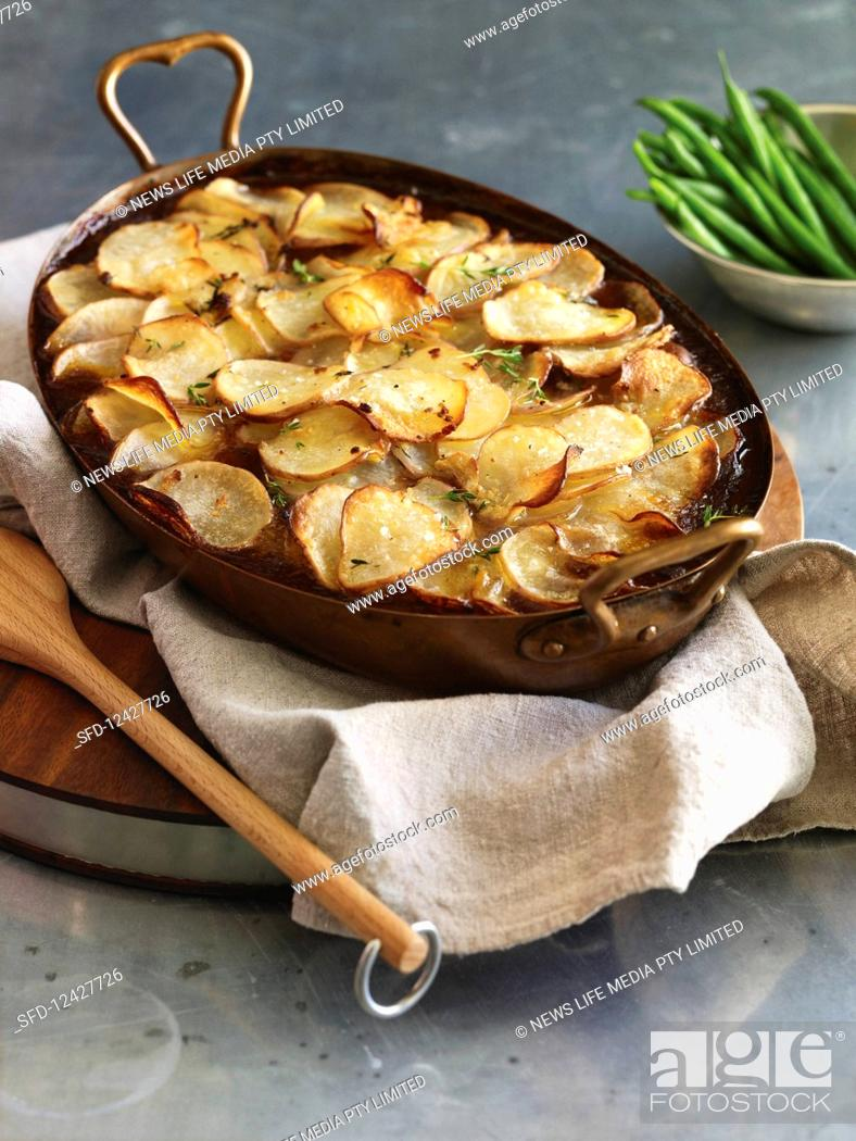 Beef and bacon casserole with crispy potato topping, Stock Photo ...