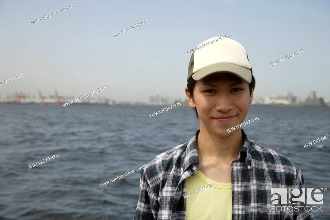 Stock Photo: Portrait of a young man on beach.
