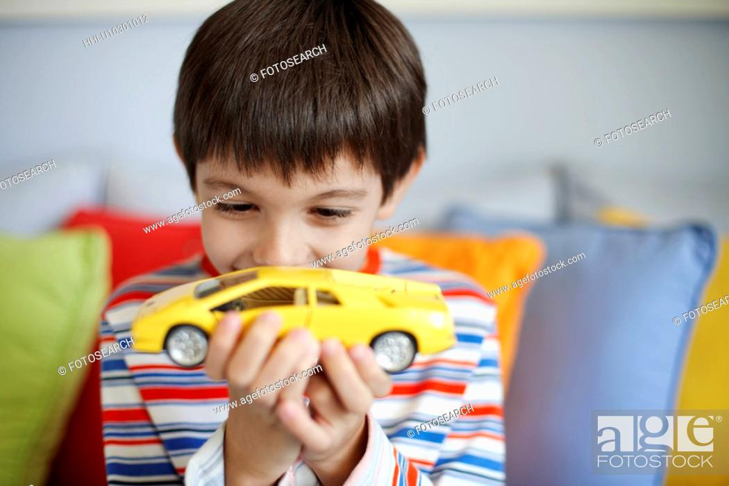 Stock Photo: Boy playing with toy car.