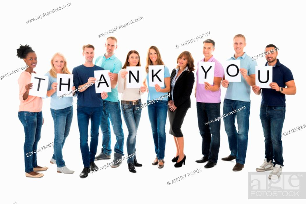 Stock Photo: Full length portrait of creative business people holding Thank You sign against white background.