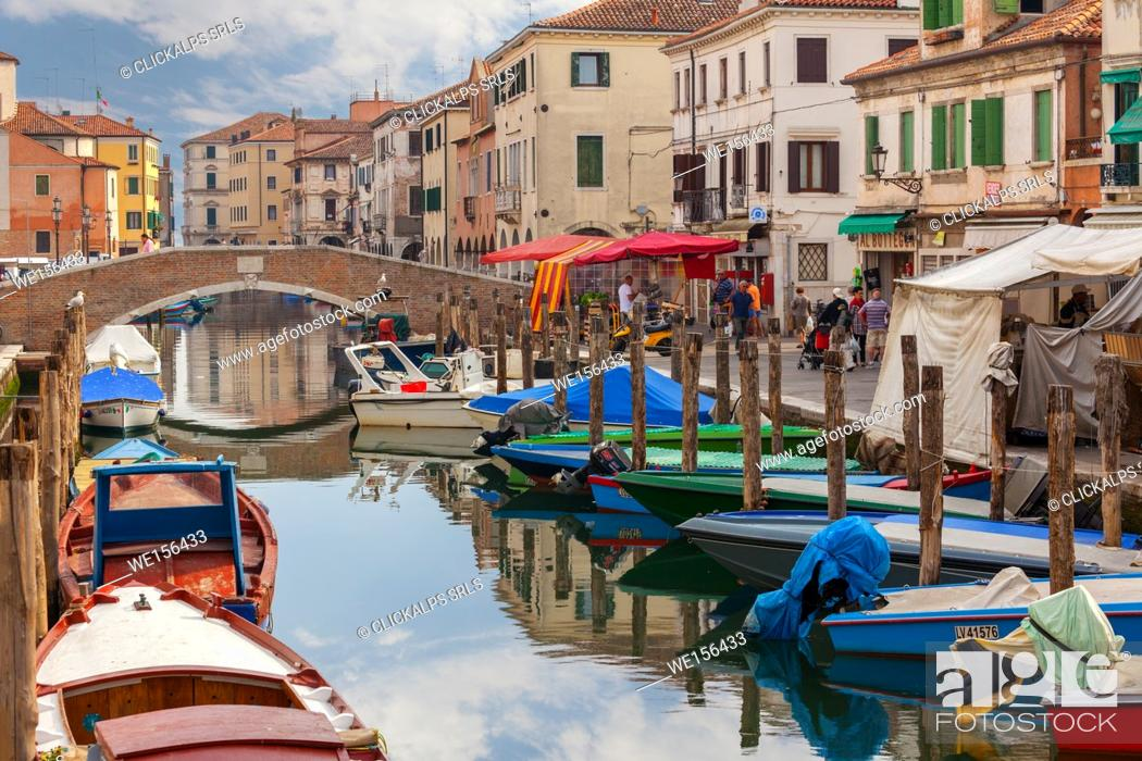 Stock Photo: Chioggia. Boats moored in the channel and the local market on the way. Veneto, Venice, Italy.