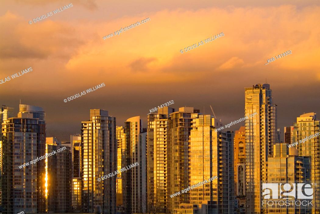 Stock Photo: colourful clouds over downtown Vancouver, BC, Canada, at sunset.