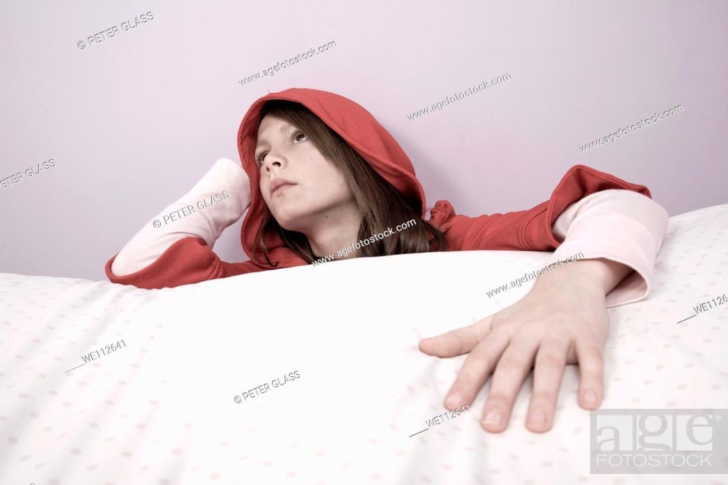 Stock Photo: Preteen girl wearing a red hood.
