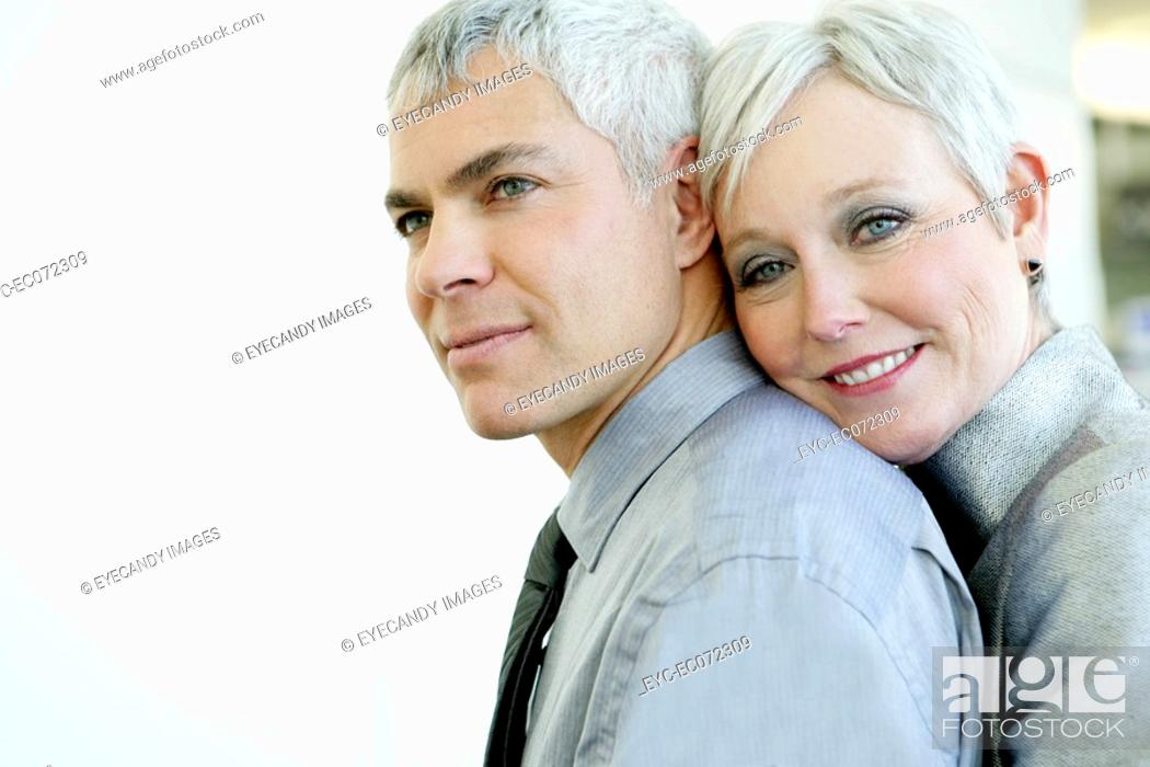 Stock Photo: Mature couple being affectionate in airport.
